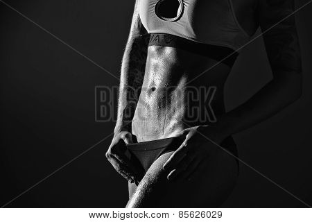 Young female fitness model posing.