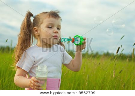 Little Girl Starts Soap Bubbles