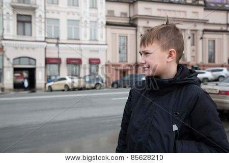 Boy in the center of Vladivostok in the spring. March, Russia.