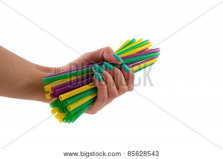Female Hand With A Bunch Of Tubes For A Cocktail