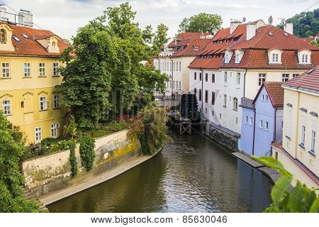 view from the Charles Bridge on the river and watermill
