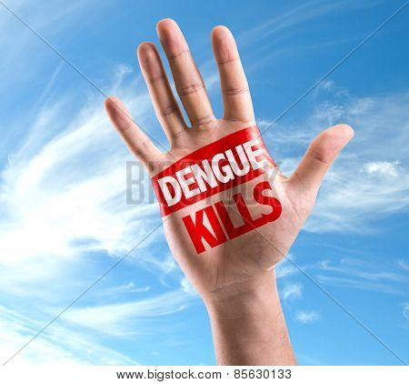 Dengue Kills sign painted on hand raised on sky background