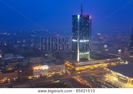 WARSAW, POLAND - 28 FEBRUARY 2014: Aerial view of the city center in Warsaw at night, Poland. Warsaw is the capital and largest city of Poland with population estimated at 1,8 million residents.