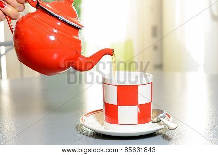 Teapot And Tea Cup On A Gray Table