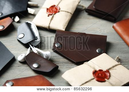 Different hand made leather man accessories on wooden background