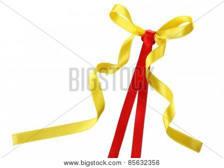 Colorful red and yellow ribbons with bow isolated on white