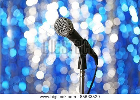 Microphone on stand on blue background