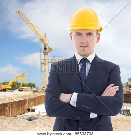 Portrait Of Young Handsome Business Man In Builder's Helmet