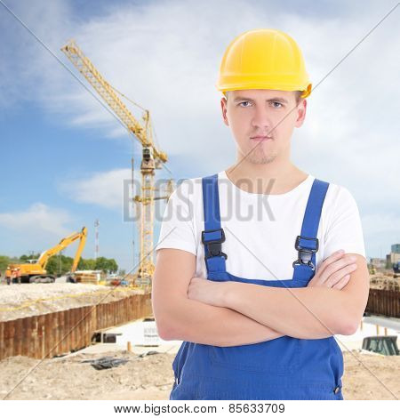 Handsome Man In Builder Uniform At Construction Site