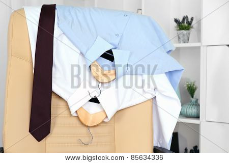 Men's clothes on chair