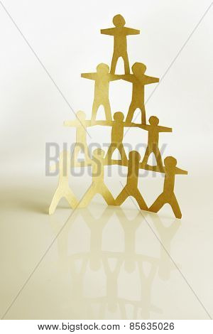 Human team pyramid holding hands