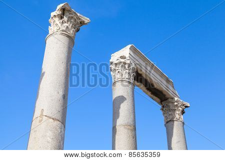 Ancient Columns And Portico Fragment On Blue Sky