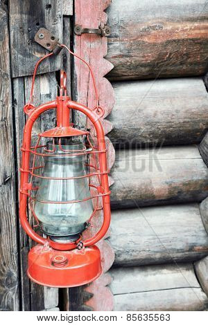 Kerosene lamp on wooden door background