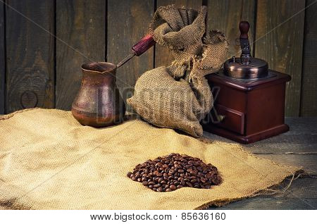 Coffee Beans, Manual Coffee Grinder And Coffee Maker On Sacking In Vintage Grunge Style. Composition