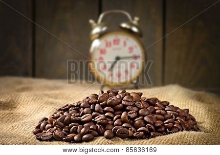 Coffee Beans, Alarm Clock On Sacking In Vintage Grunge Style.  Selective Focus