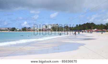 BRIDGETOWN, BARBADOS-MARCH 2, 2011: Unidentified tourists relax at the beach in Bridgetown, Barbados
