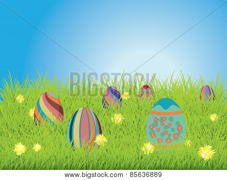 Colored Eggs On A Grass Field