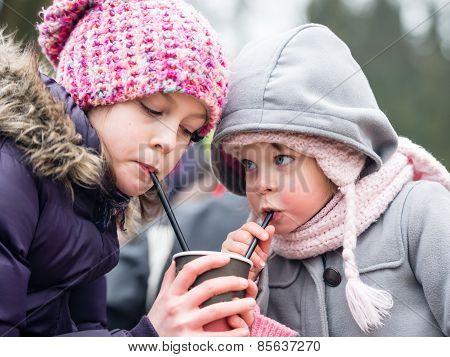 Little Girls Drinking Water Outdoors