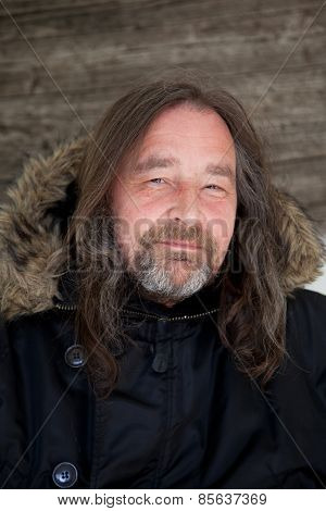 Smiling Long Hair Adult Man Wearing Hooded Jacket