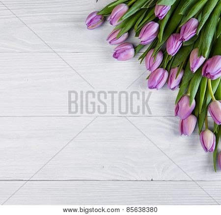 tulips over shabby white wooden table