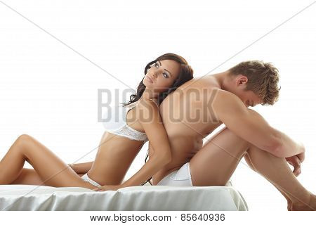 Sexy girl lying on upset guy. Concept of impotence