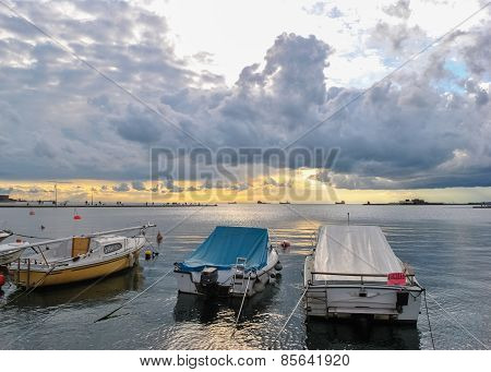 Boats At The Harbor Under A Stormy Sky