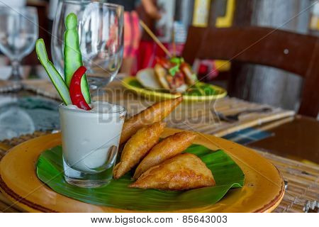 meat and vegetable samosas served in a small restaurant, meal time