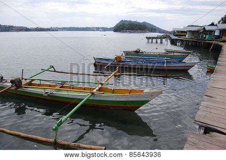Traditional Fishing Boats At Timber Pier Indonesia