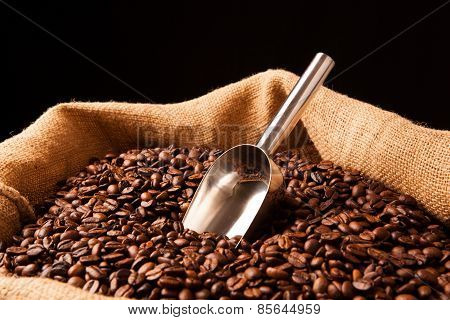 Roasted Coffee Beans With Scoop In Bag