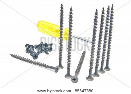 Yellow Screwdriver And Many Black Screw