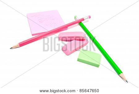 Sticky Note, Erasers And Pencils On White