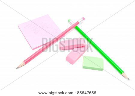 Erasers, Pencils And Sticky Note On White