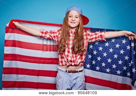 Pretty girl holding the American flag