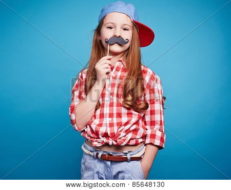 Charming girl holding moustache on a stick, like she is man