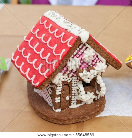 Beautiful gingerbread house on background