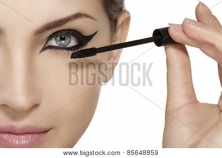 Beautiful Model Applying Mascara On Eyelashes  Close Up