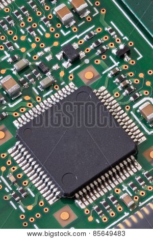 Macro shot of a circuit board with microchip in high detail