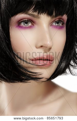 Beauty Model Hairstyled  And Pink Eye Shadows Makeup  Closeup