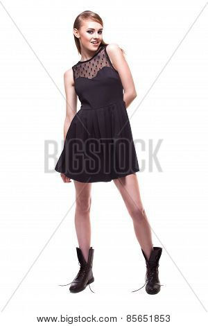 Full Growth Portrait Of Girl In Black Dress And Boots On White