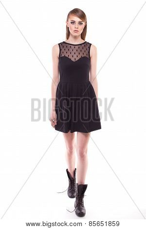 Walking Girl In Black Dress And Boots. Full Growth On White