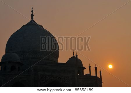 Dome Of Taj Mahal In The Fog At Sunrise