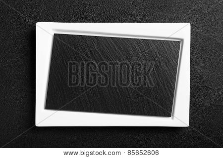 Empty White Plate With Black Stone Surface