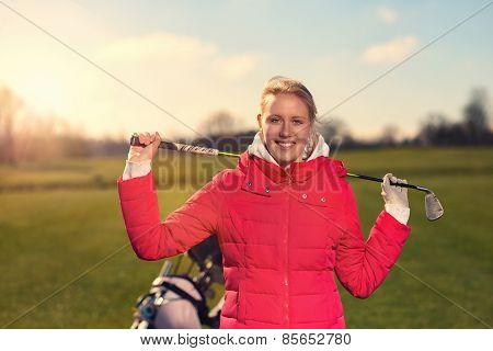 Female Golfer With A Golf Club Over Her Shoulder