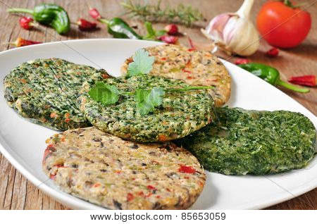 some different raw veggie burgers in a plate on a rustic wooden table