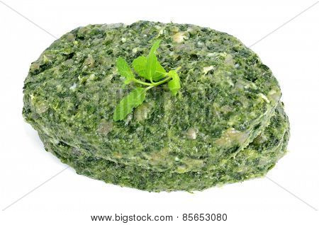 some raw veggie burgers on a white background