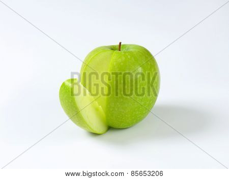 Green apple - a wedge cut off