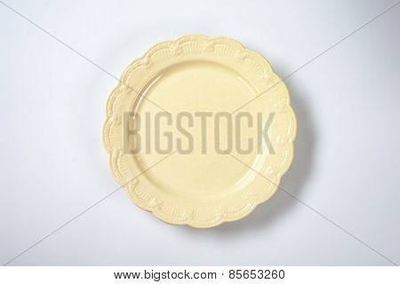 beige decorative plate on white plate