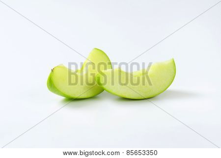 Fresh green apple wedges - studio shot