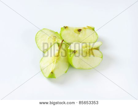 Green apple cut into quarters