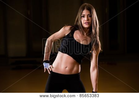 Young adult fitness woman doing exercises with a kettle bell as a part of a fitness workout